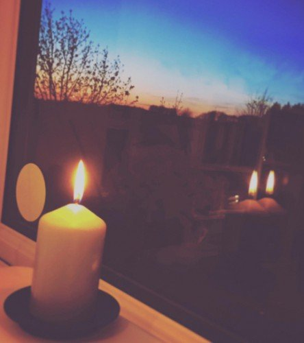A candle in a window